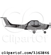 Clipart Of A Silhouetted Airplane With A Propeller Royalty Free Vector Illustration