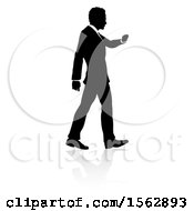 Silhouetted Business Man Walking With A Reflection Or Shadow
