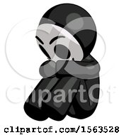 Black Little Anarchist Hacker Man Sitting With Head Down Facing Angle Left