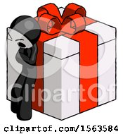 Black Little Anarchist Hacker Man Leaning On Gift With Red Bow Angle View