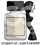 Black Little Anarchist Hacker Man Leaning Against Large Medicine Bottle