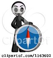 Black Little Anarchist Hacker Man Standing Beside Large Compass