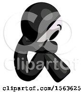 Black Little Anarchist Hacker Man Sitting With Head Down Facing Sideways Right