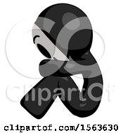 Black Little Anarchist Hacker Man Sitting With Head Down Facing Sideways Left
