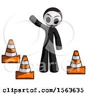 Black Little Anarchist Hacker Man Standing By Traffic Cones Waving