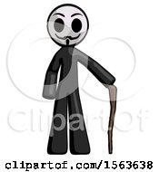 Black Little Anarchist Hacker Man Standing With Hiking Stick