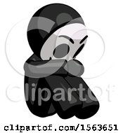 Black Little Anarchist Hacker Man Sitting With Head Down Facing Angle Right