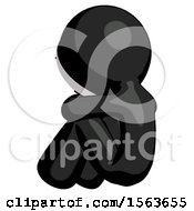 Black Little Anarchist Hacker Man Sitting With Head Down Back View Facing Left