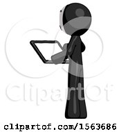 Black Little Anarchist Hacker Man Looking At Tablet Device Computer With Back To Viewer