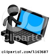 Black Little Anarchist Hacker Man Using Large Laptop Computer