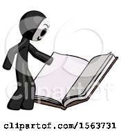 Black Little Anarchist Hacker Man Reading Big Book While Standing Beside It