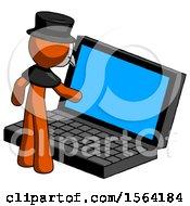 Orange Plague Doctor Man Using Large Laptop Computer
