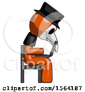 Orange Plague Doctor Man Using Laptop Computer While Sitting In Chair View From Side