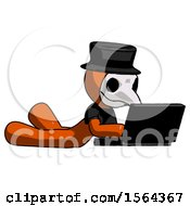 Orange Plague Doctor Man Using Laptop Computer While Lying On Floor Side Angled View