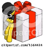 Yellow Plague Doctor Man Leaning On Gift With Red Bow Angle View