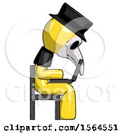 May 22nd, 2018: Yellow Plague Doctor Man Using Laptop Computer While Sitting In Chair View From Side by Leo Blanchette