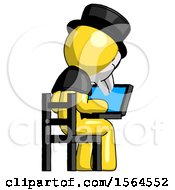 Yellow Plague Doctor Man Using Laptop Computer While Sitting In Chair View From Back