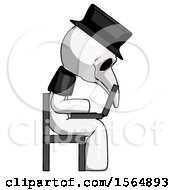 May 23rd, 2018: White Plague Doctor Man Using Laptop Computer While Sitting In Chair View From Side by Leo Blanchette