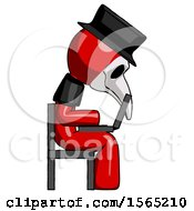 Red Plague Doctor Man Using Laptop Computer While Sitting In Chair View From Side