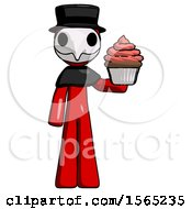 Red Plague Doctor Man Presenting Pink Cupcake To Viewer