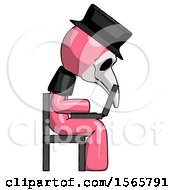 Pink Plague Doctor Man Using Laptop Computer While Sitting In Chair View From Side