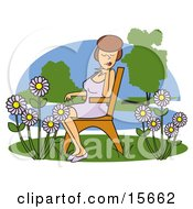 Pretty Brunette Woman Seated On A Wooden Park Bench And Enjoying The Beautiful Purple Daisy Flowers
