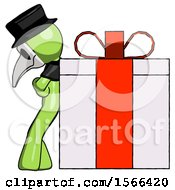 Green Plague Doctor Man Gift Concept Leaning Against Large Present