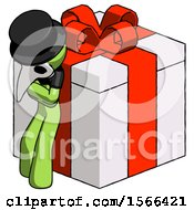 Green Plague Doctor Man Leaning On Gift With Red Bow Angle View