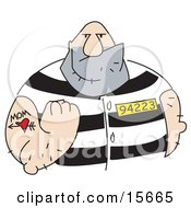 Big Tough Bald Man With A Mom And Heart Tattoo On His Arm Clenching His Fist While Wearing A Prison Uniform