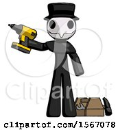 Black Plague Doctor Man Holding Drill Ready To Work Toolchest And Tools To Right