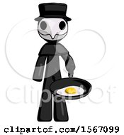 Black Plague Doctor Man Frying Egg In Pan Or Wok