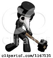 Black Plague Doctor Man Hitting With Sledgehammer Or Smashing Something At Angle