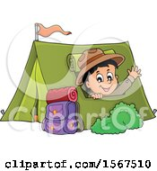 Scout Boy Camping And Waving From A Tent