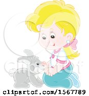 Blond Caucasian Girl Kneeling And Playing With Her Pet Bunny Rabbit