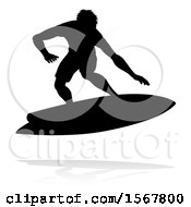 Silhouetted Surfer With A Reflection Or Shadow On A White Background