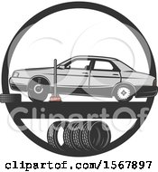 Clipart Of A Car Repair Tire Shop Design Royalty Free Vector Illustration by Vector Tradition SM
