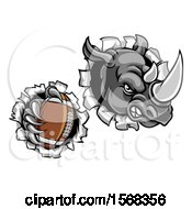 Clipart Of A Tough Rhino Monster Mascot Holding A Football In One Clawed Paw And Breaking Through A Wall Royalty Free Vector Illustration by AtStockIllustration