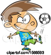 Clipart Of A Cartoon Boy Kicking A Soccer Ball Royalty Free Vector Illustration