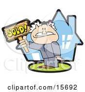 Successful Male Realtor Standing In Front Of A House And Holding A Sold Sign