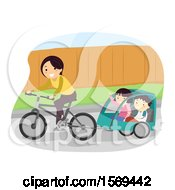 Mother Riding A Bike With Her Children In A Trailer