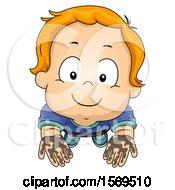 Toddler Boy Holding Up Muddy Hands