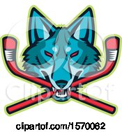 Clipart Of A Sports Mascot Of A Coyote Or Wolf Head Biting Crossed Hockey Sticks Royalty Free Vector Illustration