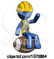 Blue Construction Worker Contractor Man Sitting On Giant Football