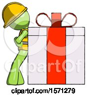 Green Construction Worker Contractor Man Gift Concept Leaning Against Large Present