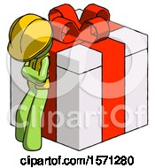 Green Construction Worker Contractor Man Leaning On Gift With Red Bow Angle View