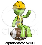 Green Construction Worker Contractor Man Sitting On Giant Football