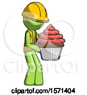 Green Construction Worker Contractor Man Holding Large Cupcake Ready To Eat Or Serve