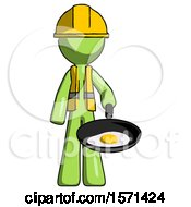 Green Construction Worker Contractor Man Frying Egg In Pan Or Wok