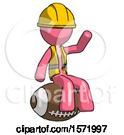 Pink Construction Worker Contractor Man Sitting On Giant Football