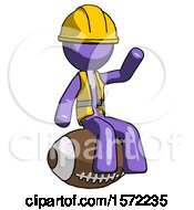 Purple Construction Worker Contractor Man Sitting On Giant Football